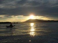 qoucher de soleil en kayak de mer