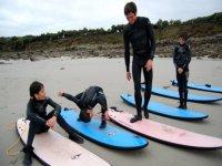 Echauffement avant le Cours de surf en Bretagne